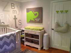 Grey and Lime Green Elephant--wall art; alphabet soup name accent wall; toy box; elephant head door hangers; book shelves; wall ruler matching color scheme.