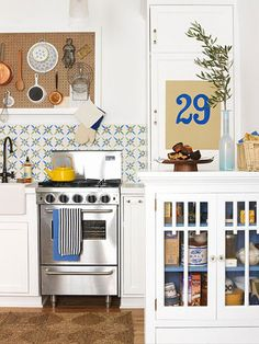 Small Kitchen Makeover The genius behind this little kitchen's redo is the skinny appliances that give it full-size function. A framed pegboard, inspired by one in legendary cook Julia Child's kitchen, provides practical and livable storage.