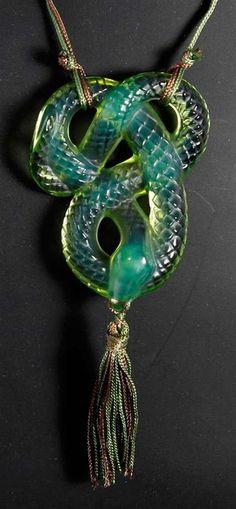 A vintage Lalique glass pendant