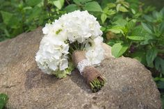 a simple, classic white bouquet wrapped in burlap and lace