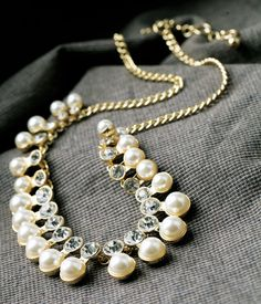 Alluring Ivory Simulated Pearl Necklace   Read More:   http://ownjewelry.com/alluring-ivory-simulated-pearl-necklace.html