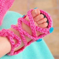 These Baby Button Gladiator Sandals are perfect for summer! Your baby girl will look adorable in these easy-to-make crochet shoes.