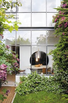 Large glass windows leading to a garden + Interior By: Marion Alberge + http://www.marionalberge.com/#_