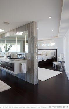 Elegant yet streamlined master bathroom. A wall hung vanity always helps create an illusion of space (or more space).