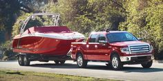 Red 2014 Ford F-150 Truck towing boat trailer  A 2014 not a 2015 F-150 for comparison