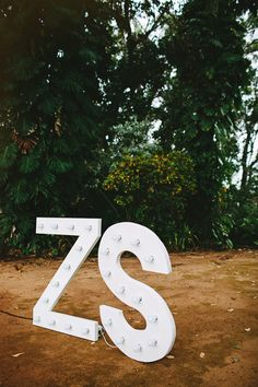 giant marquee letters // photo by Pat Furey // View more: http://ruffledblog.com/hawaiian-island-wedding/