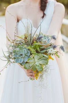 succulent and air plant bouquet, photo by Dearheart Photos http://ruffledblog.com/old-mac-daddy-wedding #weddingbouquet #succulents