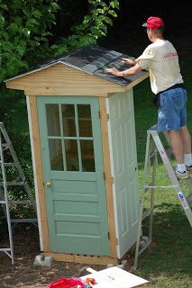 Tool Shed - exterior made from salvaged doors & interior shelves made from an old tabletop.  The windowed door was chosen so it didn't look like an outhouse.  Such a great use of salvaged pieces!