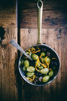 // spicy orange + fennel marinated olives