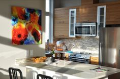 A customer brightens their newly remodeled kitchen with a stunning acrylic face mount using a digital photograph of Dale Chihuly blown glass.