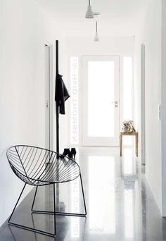 entry hall glossy floor, white walls floor, lounge chairs, hallway, white interiors