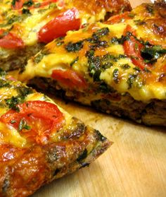 Frittata - Quick Paleo Meals - Paleo Diet  1 bunch spinach 1/2 onion, diced 1 tomato, diced fresh basil Italian sausage meat (meat from 2-3 links, casings removed) 1 c Italian blend of cheeses (optional) 12 eggs 1 tsp garlic powder splash of water or full fat milk salt and pepper to taste 1-2 tbsp coconut or olive oil