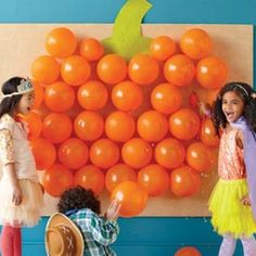 pumpkin (or easter egg) balloon dart game. Fill with candy and if they pop it, they win it! :)  I'm scared of popping balloons so there would've been no candy for me but it's still a cool idea