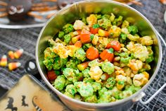 In saucepan, melt ½ cup butter. Stir in 1 cup sugar, ¼ cup corn syrup and ½ tsp of salt and bring to boil. Once boiling, remove from heat stir in 1 ½ tsp green food coloring. Add 1 tsp baking powder and stir. Place 15-20 cups of popcorn on baking sheets and pour the sugar mixture over it. Place in the oven at 250⁰ for 1 hour, stirring occasionally. Once cooled, mix in candy corn or pumpkins before serving.