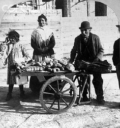 Bread venders of Naples, a familiar class in the most populous city of Italy. (Man with bread on cart, woman and girl)    #TuscanyAgriturismoGiratola
