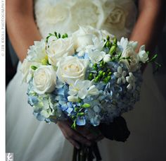 Blue hydrangeas, green berries, white roses