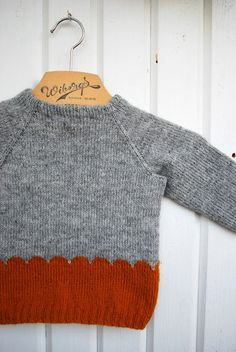 I love the simplicity and the graphic design of this little sweater...