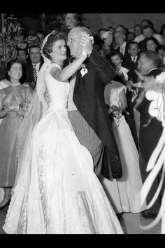 Jackie Kennedy dances with her father-in-law Joseph Kennedy Sr. at her wedding reception at Hammersmith Farm in Newport RI, September 12, 1953.
