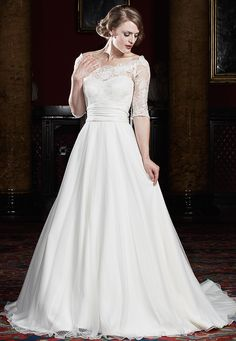 Romantic vintage. Sweetheart neckline, strapless wedding dress which has a gorgeous dotted lace and tulle bodice and skirt. The fitted lace bolero has elbow length sleeves and a flattering belt.