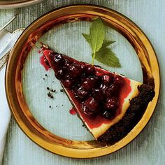 White Chocolate-Cranberry Cheesecake | This cake is the perfect ending to a meal—from the deep red cranberry topping to the velvety smooth comforting bites. | SouthernLiving.com