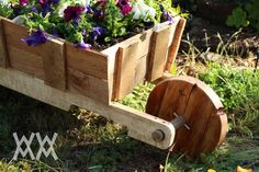 Wooden wheelbarrow made from free pallet wood. Great garden planter project.