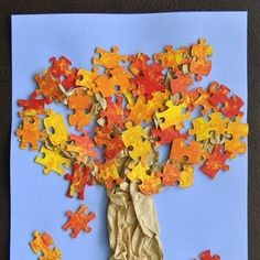 Need something to do as the leaves are changing? Here is a great art activity that you can do at home using puzzles with lost pieces. Create a tree using assorted pieces. #simple #kids #kindergarten #children #September #Halloween #October #Fall #autumn #DIY #simple #craft #BacktoSchool