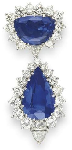 A SAPPHIRE AND DIAMOND BROOCH, BY HARRY WINSTON   Set with a modified half-moon sapphire, 22.01 carats, within a circular-cut diamond surround, to the triangular-cut diamond link, suspending a detachable pendant, set with a pear-shaped sapphire, 27.39 carats, within a graduated circular-cut diamond surround terminating with twin-set triangular-cut diamonds,Signed Harry Winston .   the probable geographic origin is Sri Lanka. Indications of heating .