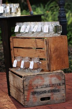 Mason jars displayed as escort / name cards. They put a sign out that said use it for the night for whatever feels right.