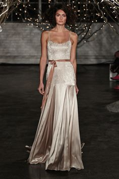Spaghetti strap wedding dress in a beautiful champagne silk with a pretty ribbon sash tied in a bow at the waist