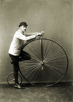A moustached man and his penny-farthing circa 1880s - so legit.