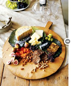 A cheese plate should include a blue cheese, a firm cheese such as cheddar, and a creamy one such as brie.  Nuts, fresh and dried fruits, and bread or crackers complete it.