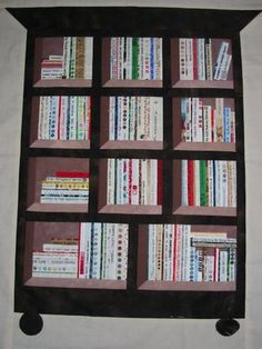 Selvage library quilt by Marquerite van Eijck (Netherlands), posted at Selvage Quilter.  The 'books' are made from selvages.