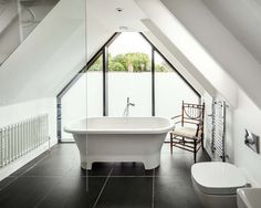 The bathroom inside a house in Oxford designed by Waind Gohil Architects.