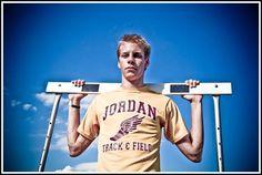 Senior Guy track field hurdle sky outdoor