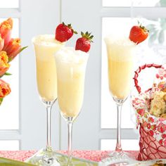 Creamsicle Mimosa. Orange juice, half & half, superfine sugar, grated orange peel, champagne, & fresh strawberries. Hello.