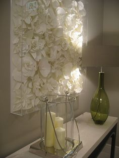 Genius - spray paint faux flowers one color and attach to a canvas and cover with clear box frame.  For the stairwell??