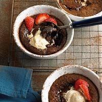 SWEET - Gooey Chocolate Pudding Cakes - don't these look delicious?  The bit of ice cream and strawberries adds a light touch to this indulgent dessert!