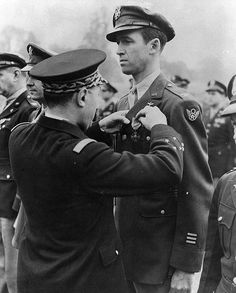 Lt. Gen. Valin, Chief of Staff, French Air Force, awarding Croix De Guerre with palm to Col. James Stewart