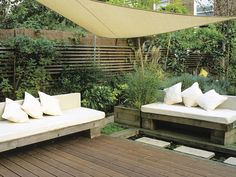 Screened Outdoor Room: A lightweight and elegant sail canopy provides shade and intimacy in this small urban garden. (DK - Garden Design