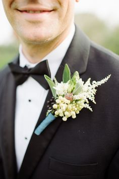 boutonniere, photo by L. Hewitt Photography http://ruffledblog.com/19th-century-stone-house-inspiration #grooms #groomsmen