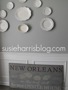 love the softness -- sherwin williams comfort gray paint with white decorative plates