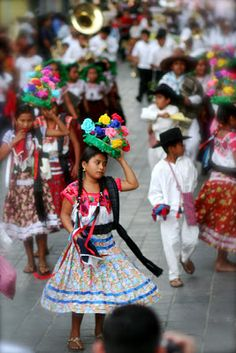 Young girl in traditional Oaxacan dress during a parade