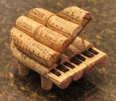 Baby Grand Piano of 19 wine corks 3 small corks and some cut up skewers