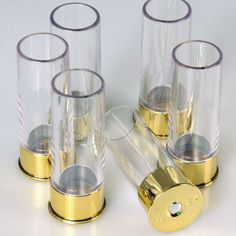 Shot glasses that resemble shot gun shells.  These come along with a belt that hold two fifths in its holsters.  Cowboy up!
