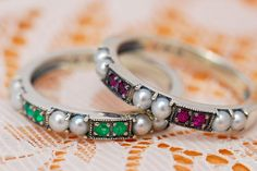 Emerald, ruby and seed pearl stackable rings.  I love plain bands with interesting working.