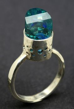 This is a very cool ring I think the stone is Aqua Aura