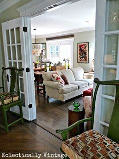 Great french doors dividing rooms.  Beautiful family room decor - love the layout and colors eclecticallyvintage.com