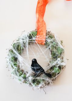 Cobweb Wreath #halloween  Source: Hello Natural - hellonatural.co/diy-wreath-3-ways-customize-halloween-thanksgivi  View entire slideshow: Decorating for a Chic Halloween on http://www.stylemepretty.com/collection/729/