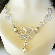 This wirework can be achieved with the Wire Jig we have..