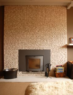 Dimensional stone tile fireplace